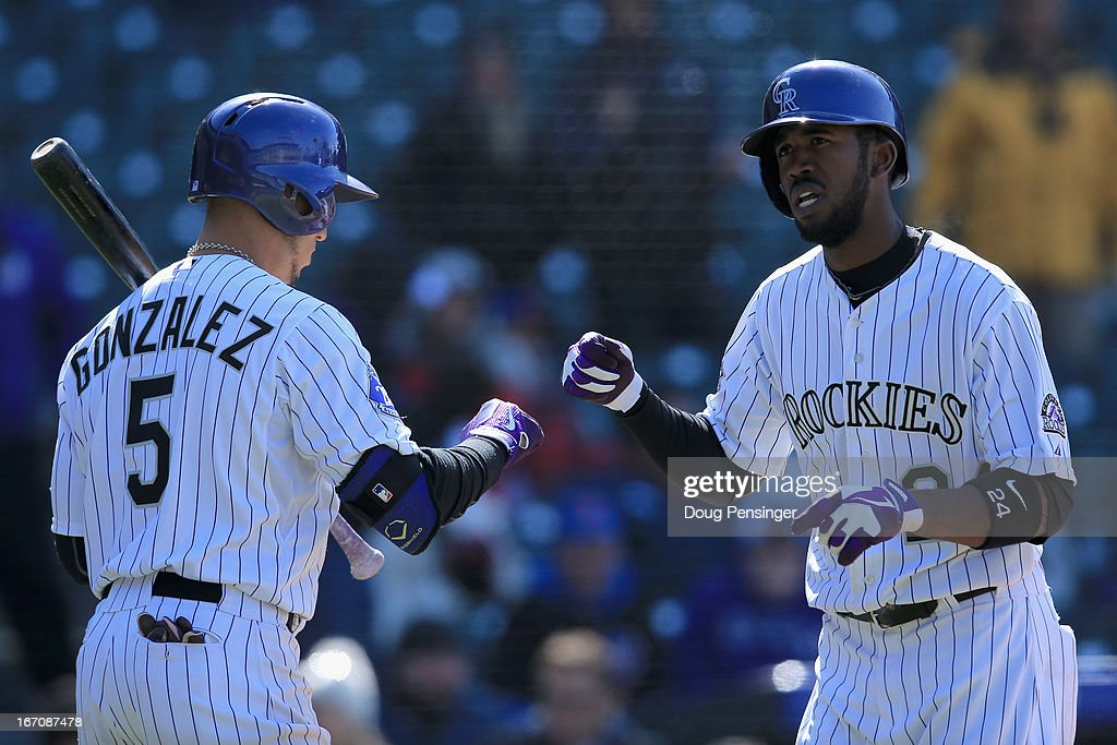 <a gi-track='captionPersonalityLinkClicked' href=/galleries/search?phrase=Dexter+Fowler&family=editorial&specificpeople=4949024 ng-click='$event.stopPropagation()'>Dexter Fowler</a> #24 of the Colorado Rockies celebrates his solo home run off of relief pitcher Jeremy Hefner #53 of the New York Mets with Carlos Gonzalez #5 of the Colorado Rockies in the eighth inning at Coors Field on April 18, 2013 in Denver, Colorado. The Rockies defeated the Mets 11-3.