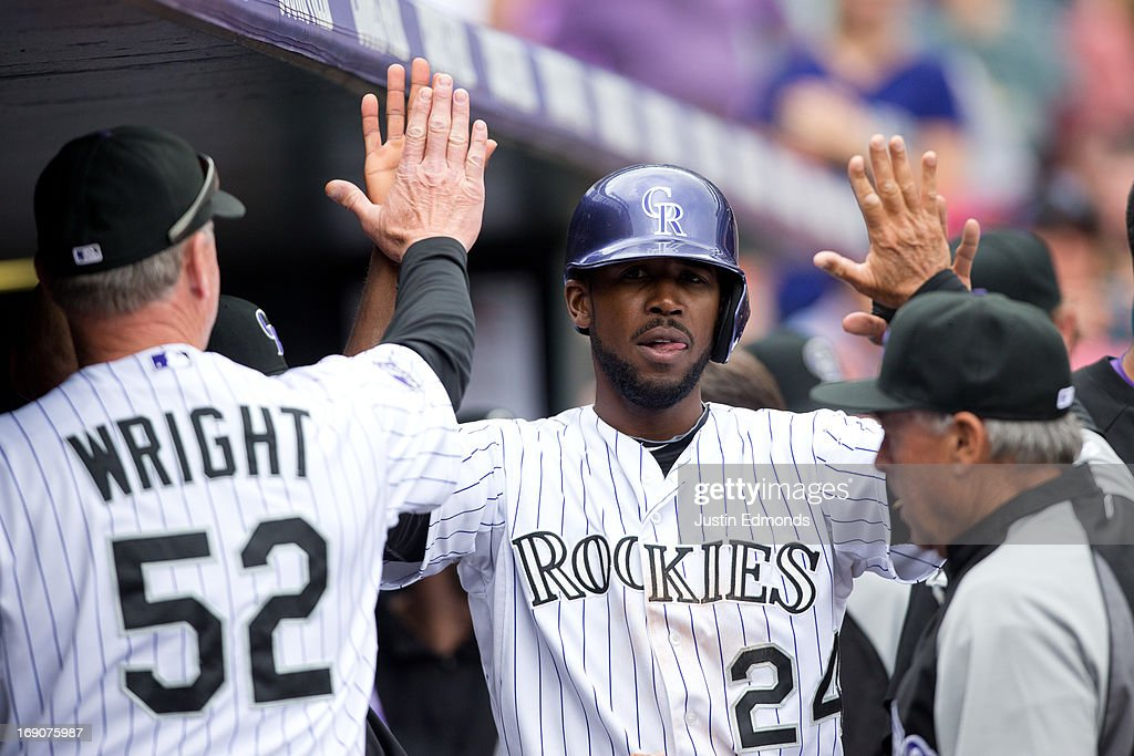 <a gi-track='captionPersonalityLinkClicked' href=/galleries/search?phrase=Dexter+Fowler&family=editorial&specificpeople=4949024 ng-click='$event.stopPropagation()'>Dexter Fowler</a> #24 of the Colorado Rockies celebrates in the dugout after scoring during the fifth inning against the San Francisco Giants at Coors Field on May 19, 2013 in Denver, Colorado. The Rockies defeated the Giants 5-0.