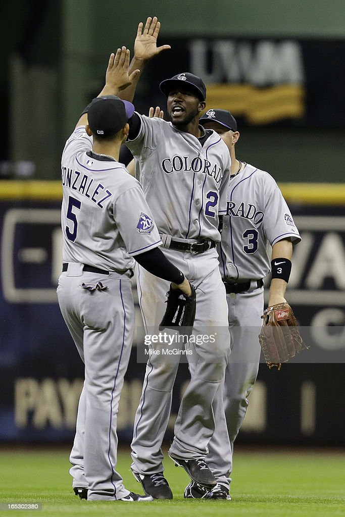 <a gi-track='captionPersonalityLinkClicked' href=/galleries/search?phrase=Dexter+Fowler&family=editorial&specificpeople=4949024 ng-click='$event.stopPropagation()'>Dexter Fowler</a> #24 of the Colorado Rockies celebrates with Carlos Gonzalez #5 and <a gi-track='captionPersonalityLinkClicked' href=/galleries/search?phrase=Michael+Cuddyer&family=editorial&specificpeople=208127 ng-click='$event.stopPropagation()'>Michael Cuddyer</a> #3 after the win over the Milwaukee Brewers 8-4 at Miller Park on April 2, 2013 in Milwaukee, Wisconsin.