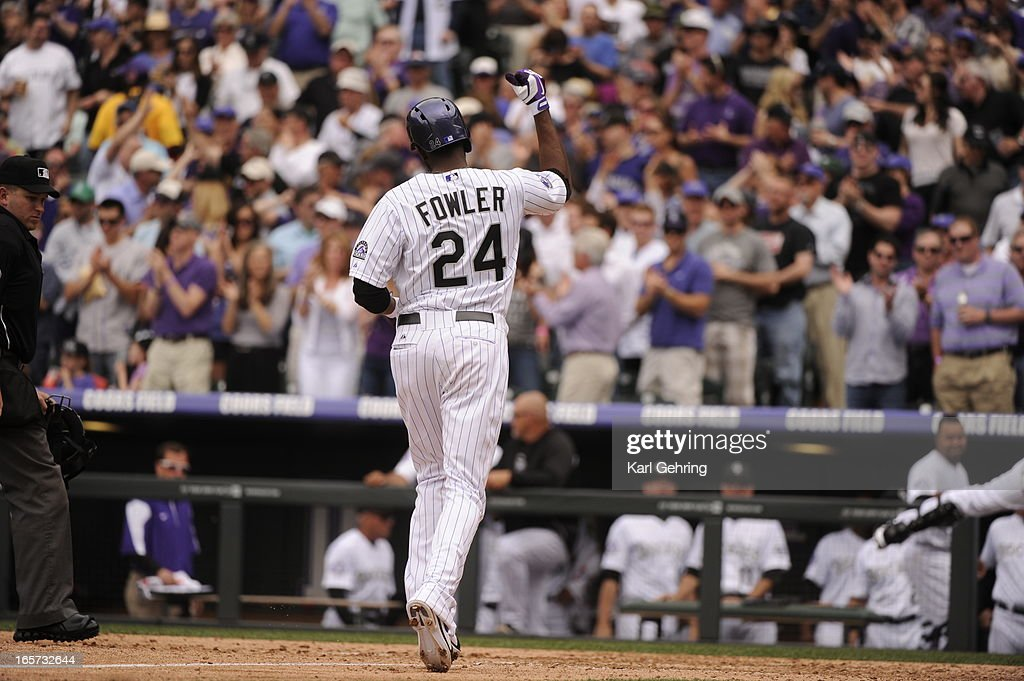 Dexter Fowler (24) of the Colorado Rockies crosses home plate after hitting a home run in the fifth inning. The Colorado Rockies took on the San Diego Padres on Opening Day at Coors Field in Denver, Colorado.