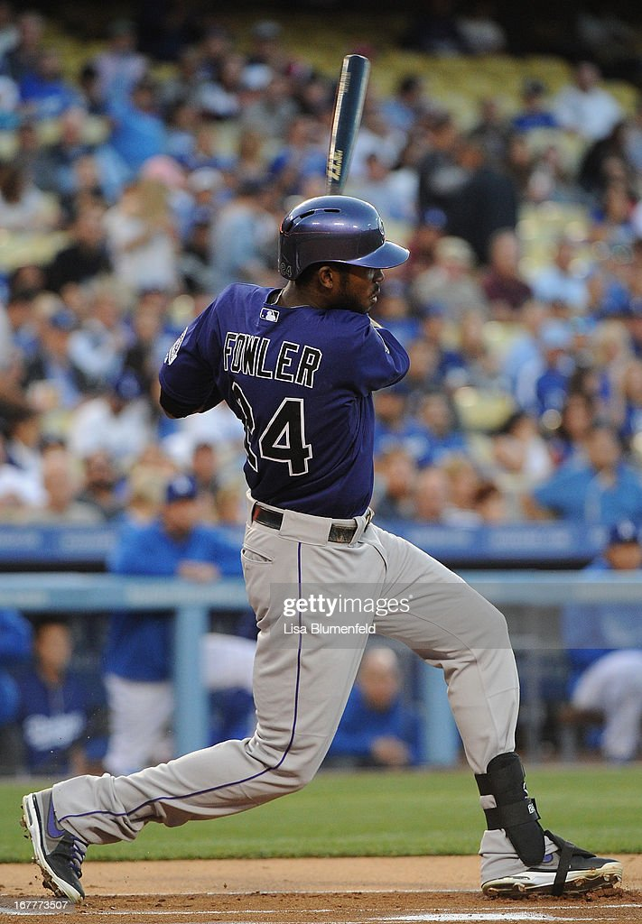 <a gi-track='captionPersonalityLinkClicked' href=/galleries/search?phrase=Dexter+Fowler&family=editorial&specificpeople=4949024 ng-click='$event.stopPropagation()'>Dexter Fowler</a> #24 of the Colorado Rockies hits a homerun in the first inning against the Los Angeles Dodgers at Dodger Stadium on April 29, 2013 in Los Angeles, California.