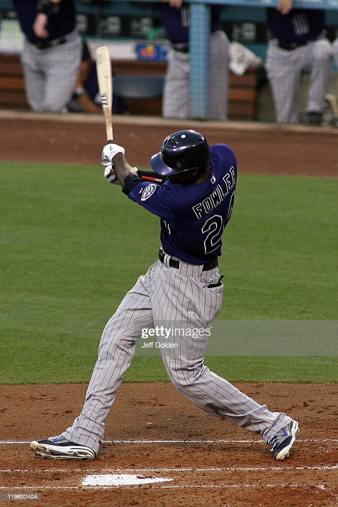 <a gi-track='captionPersonalityLinkClicked' href=/galleries/search?phrase=Dexter+Fowler&family=editorial&specificpeople=4949024 ng-click='$event.stopPropagation()'>Dexter Fowler</a> #24 of the Colorado Rockies hits a RBI single against the Los Angeles Dodgers in the second inning of the game at Dodger Stadium on July 25, 2011 in Los Angeles, California.