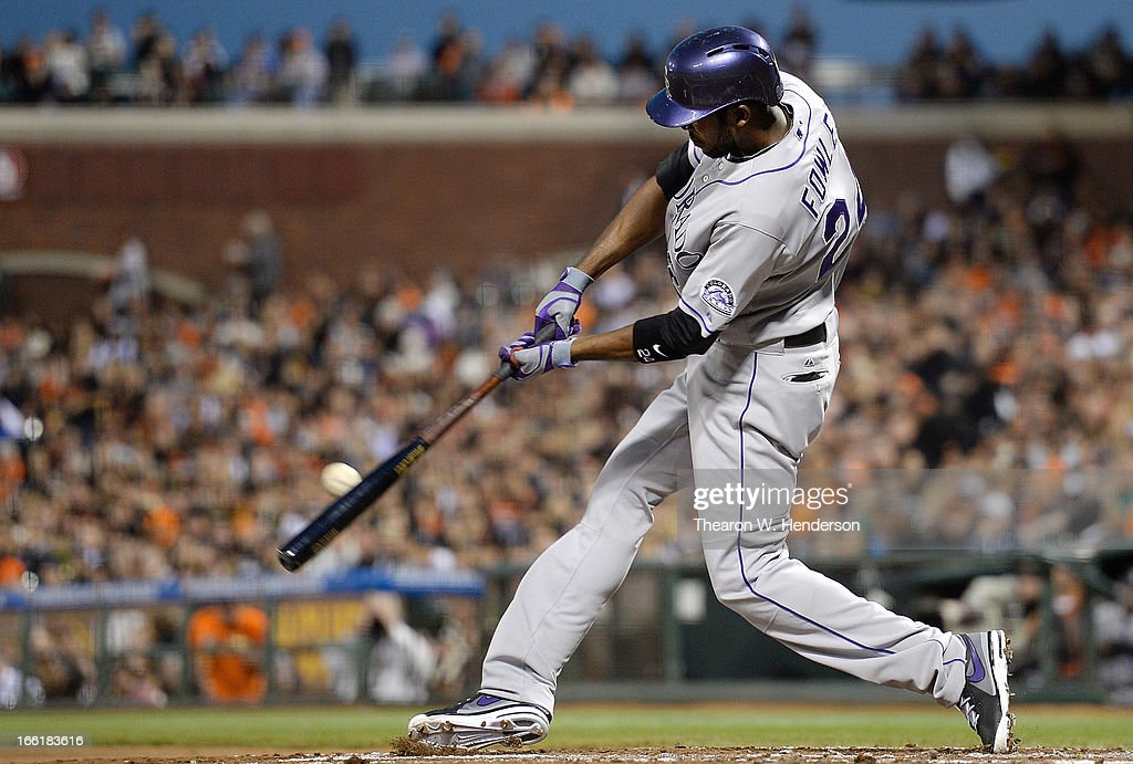 <a gi-track='captionPersonalityLinkClicked' href=/galleries/search?phrase=Dexter+Fowler&family=editorial&specificpeople=4949024 ng-click='$event.stopPropagation()'>Dexter Fowler</a> #24 of the Colorado Rockies hits a two run double against the San Francisco Giants in the second inning at AT&T Park on April 9, 2013 in San Francisco, California.