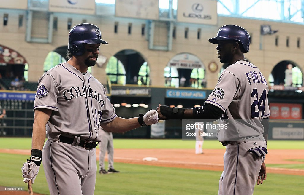 <a gi-track='captionPersonalityLinkClicked' href=/galleries/search?phrase=Dexter+Fowler&family=editorial&specificpeople=4949024 ng-click='$event.stopPropagation()'>Dexter Fowler</a> #24 of the Colorado Rockies is greeted by <a gi-track='captionPersonalityLinkClicked' href=/galleries/search?phrase=Todd+Helton&family=editorial&specificpeople=200735 ng-click='$event.stopPropagation()'>Todd Helton</a> #17 after scoring a run in the first inning against the Houston Astros at Minute Maid Park on May 28, 2013 in Houston, Texas.