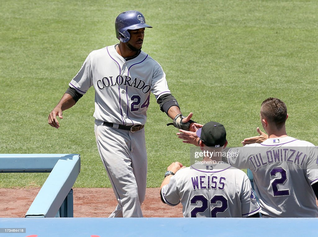 <a gi-track='captionPersonalityLinkClicked' href=/galleries/search?phrase=Dexter+Fowler&family=editorial&specificpeople=4949024 ng-click='$event.stopPropagation()'>Dexter Fowler</a> #24 of the Colorado Rockies is greeted by Troy Tulawitzki #2 and manager <a gi-track='captionPersonalityLinkClicked' href=/galleries/search?phrase=Walt+Weiss&family=editorial&specificpeople=239045 ng-click='$event.stopPropagation()'>Walt Weiss</a> as he returns to the dugout after scoring a run in the first inning against the Los Angeles Dodgers at Dodger Stadium on July 14, 2013 in Los Angeles, California. The Rockies won 3-1.