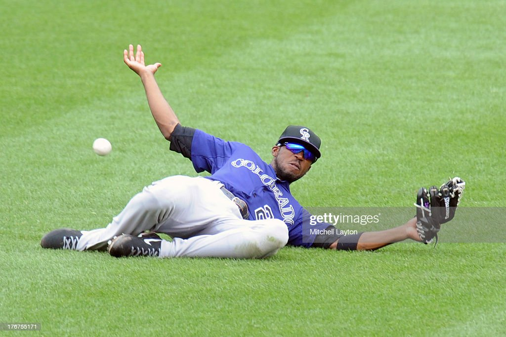<a gi-track='captionPersonalityLinkClicked' href=/galleries/search?phrase=Dexter+Fowler&family=editorial&specificpeople=4949024 ng-click='$event.stopPropagation()'>Dexter Fowler</a> #24 of the Colorado Rockies misses a fly ball hit by Taylor Teagarden #31 of the Baltimore Orioles in the sixth inning during a baseball game on August 18, 2013 at Oriole Park at Camden Yards in Baltimore, Maryland. The Orioles won 7-2.