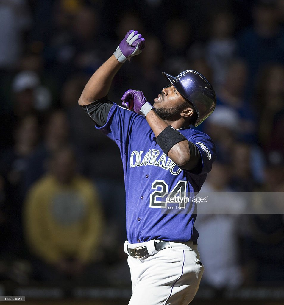 Dexter Fowler #24 of the Colorado Rockies reacts to his solo home run in the ninth inning on opening day at Miller Park on April 1, 2013 in Milwaukee, Wisconsin. The Milwaukee Brewers defeated the Colorado Rockier 5-4.