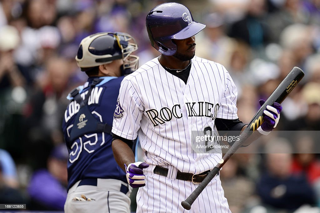 Dexter Fowler (24) of the Colorado Rockies reacts to striking out against the Tampa Bay Rays during the Rockies' 8-3 loss. The Tampa Bay Rays took two of three games from the Rockies in the series.