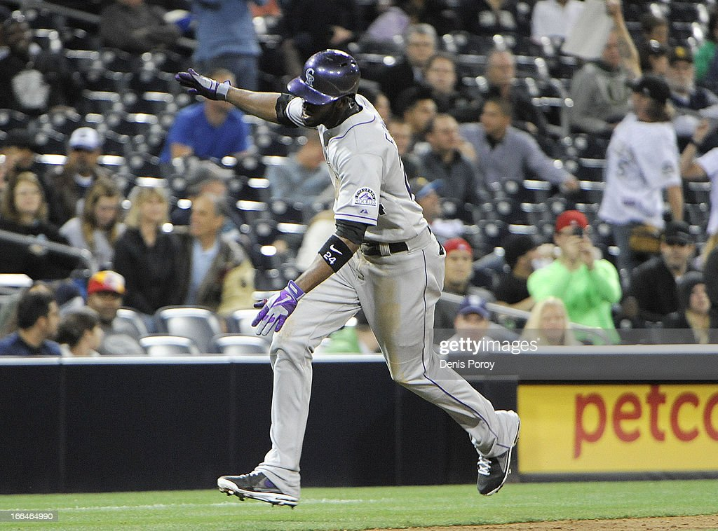 Dexter Fowler #24 of the Colorado Rockies rounds the bases after hitting a solo home run in the ninth inning against the San Diego Padres at Petco Park on April 12, 2013 in San Diego, California. The Rockies won 7-5.