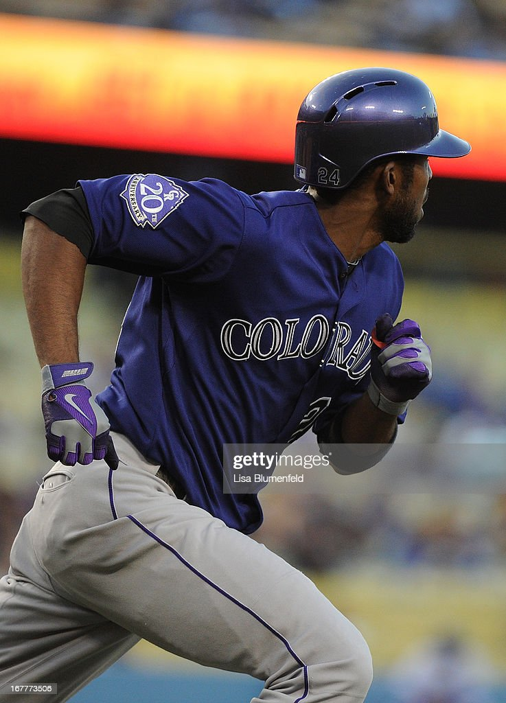 <a gi-track='captionPersonalityLinkClicked' href=/galleries/search?phrase=Dexter+Fowler&family=editorial&specificpeople=4949024 ng-click='$event.stopPropagation()'>Dexter Fowler</a> #24 of the Colorado Rockies runs the bases after hitting a homerun in the first inning against the Los Angeles Dodgers at Dodger Stadium on April 29, 2013 in Los Angeles, California.