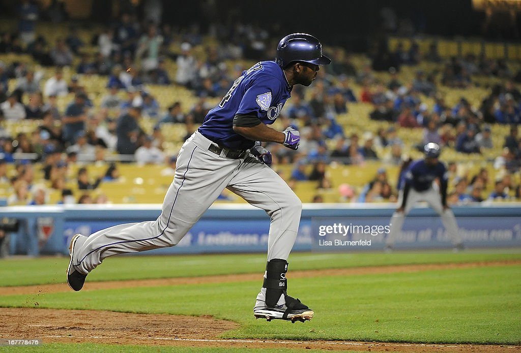 Dexter Fowler #24 of the Colorado Rockies runs the bases after hitting a single in the sixth inning against the Los Angeles Dodgers at Dodger Stadium on April 29, 2013 in Los Angeles, California.