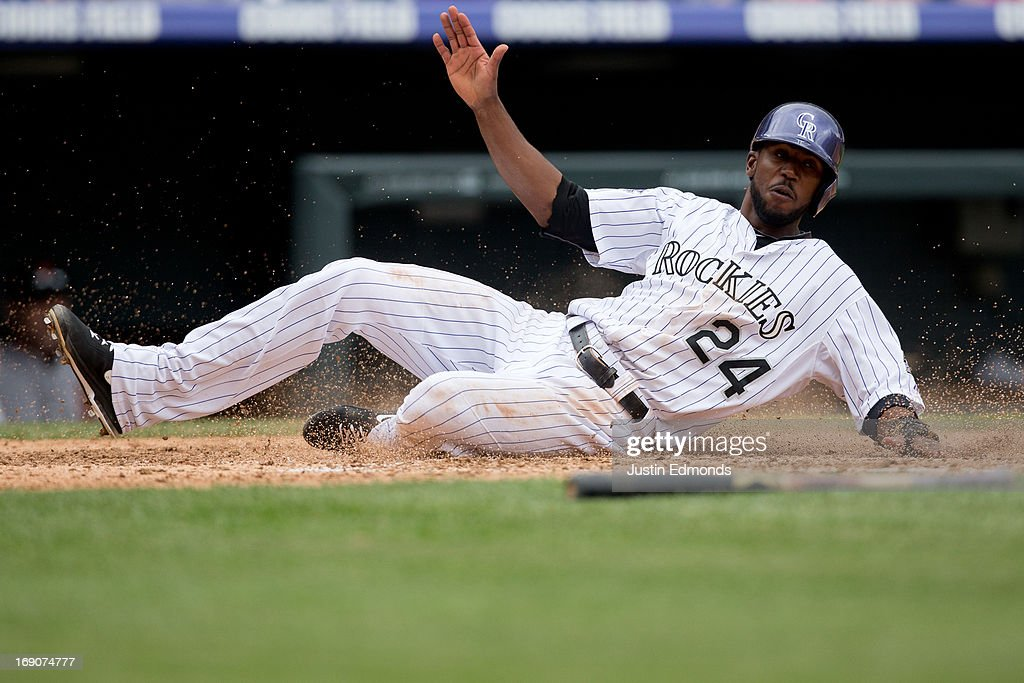 <a gi-track='captionPersonalityLinkClicked' href=/galleries/search?phrase=Dexter+Fowler&family=editorial&specificpeople=4949024 ng-click='$event.stopPropagation()'>Dexter Fowler</a> #24 of the Colorado Rockies scores during the fifth inning against the San Francisco Giants at Coors Field on May 19, 2013 in Denver, Colorado. The Rockies defeated the Giants 5-0.