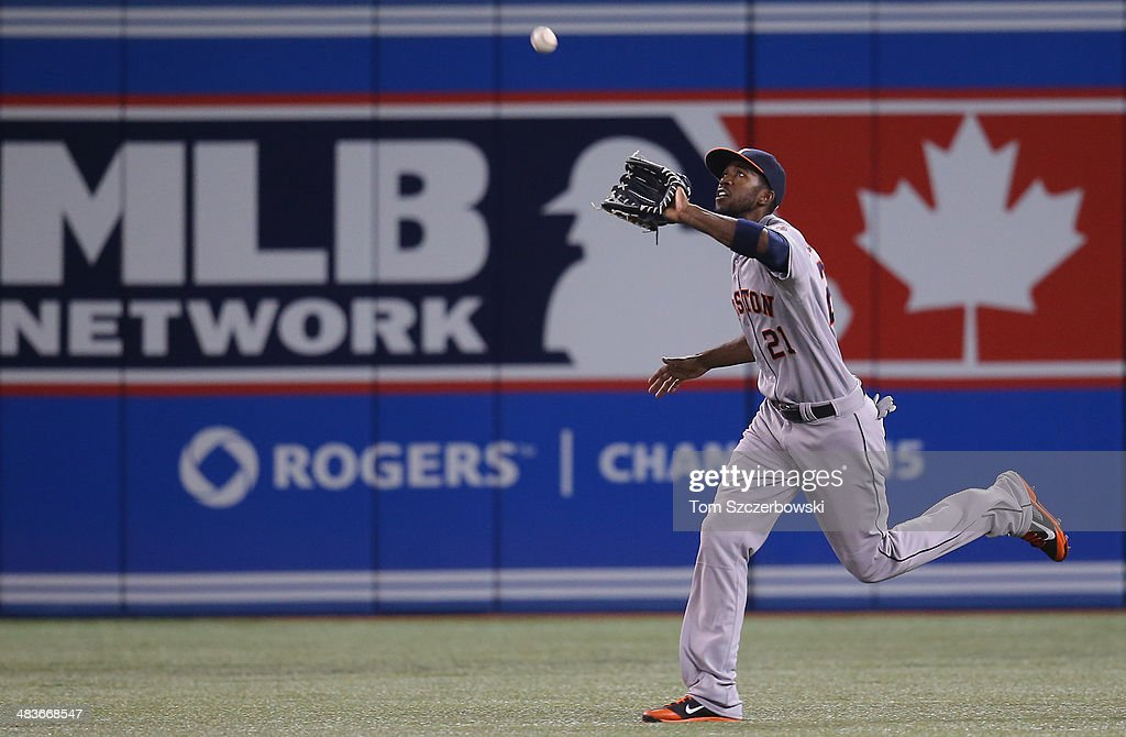<a gi-track='captionPersonalityLinkClicked' href=/galleries/search?phrase=Dexter+Fowler&family=editorial&specificpeople=4949024 ng-click='$event.stopPropagation()'>Dexter Fowler</a> #21 of the Houston Astros catches a fly ball in the fourth inning during MLB game action against the Toronto Blue Jays on April 9, 2014 at Rogers Centre in Toronto, Ontario, Canada.