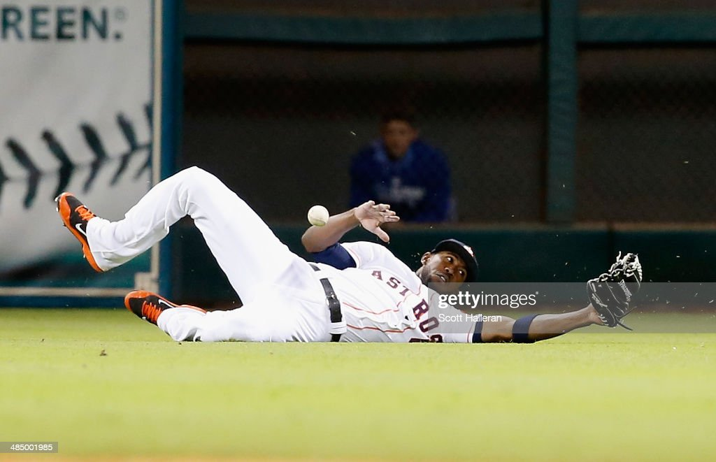 <a gi-track='captionPersonalityLinkClicked' href=/galleries/search?phrase=Dexter+Fowler&family=editorial&specificpeople=4949024 ng-click='$event.stopPropagation()'>Dexter Fowler</a> of the Houston Astros dives for a ball in center field in the sixth inning against the Kansas City Royals at Minute Maid Park on April 15, 2014 in Houston, Texas. All uniformed team members are wearing jersey number 42 in honor of Jackie Robinson Day.