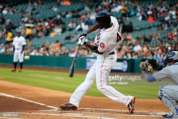 Dexter Fowler of the Houston Astros hits a double in the first inning against the Kansas City Royals at Minute Maid Park on April 15 2014 in Houston...