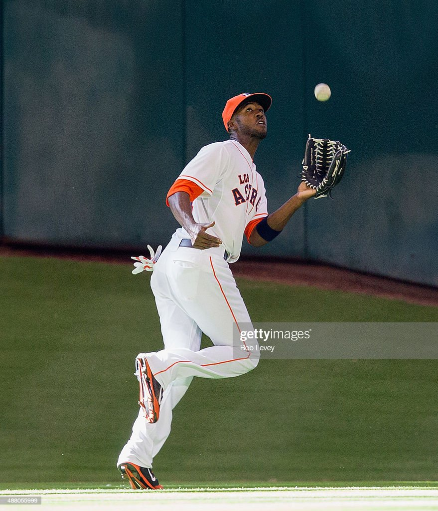 <a gi-track='captionPersonalityLinkClicked' href=/galleries/search?phrase=Dexter+Fowler&family=editorial&specificpeople=4949024 ng-click='$event.stopPropagation()'>Dexter Fowler</a> #21 of the Houston Astros makes a catch on a fly ball hit by Cole Gillespie #16 of the Seattle Mariners at Minute Maid Park on May 3, 2014 in Houston, Texas.