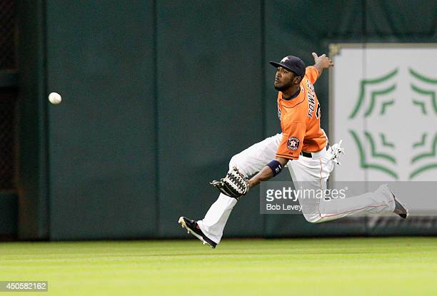 Dexter Fowler of the Houston Astros makes a sliding catch in the third inning against the Tampa Bay Rays at Minute Maid Park on June 13 2014 in...