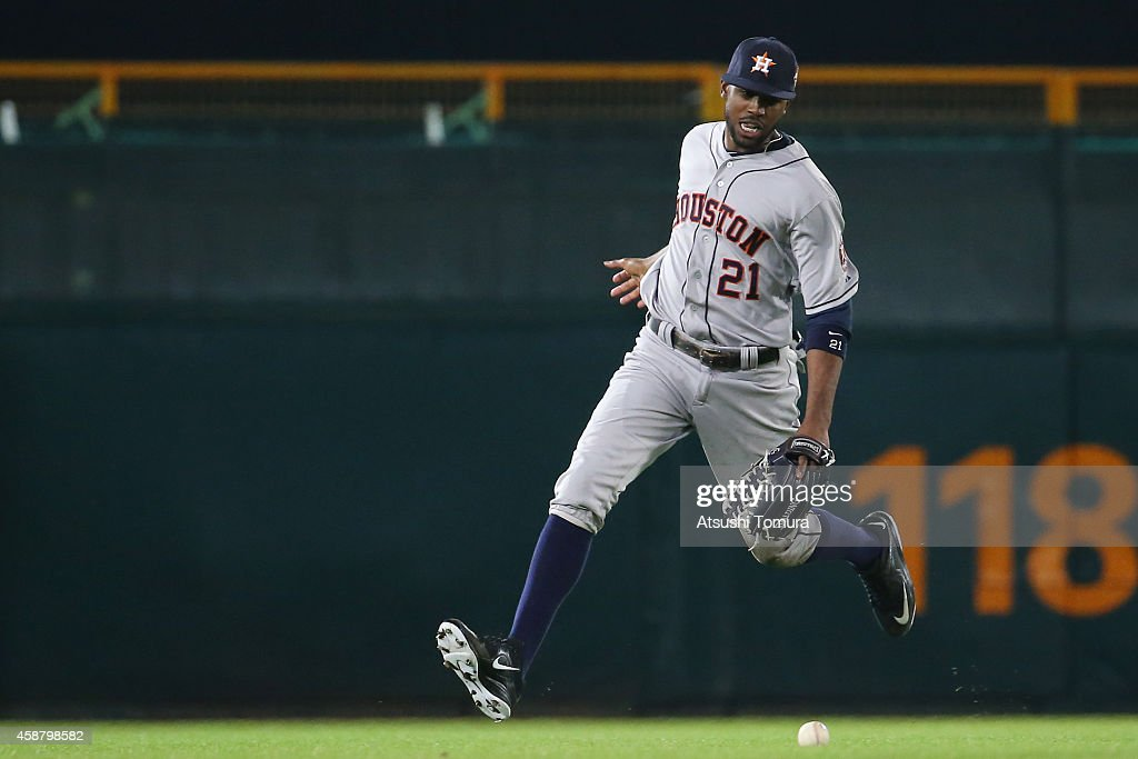 Dexter Fowler of the Houston Astros runs to the ball during the friendly match between Hanshin Tigers and Yomiuri Giants at the Hanshin Koshien...