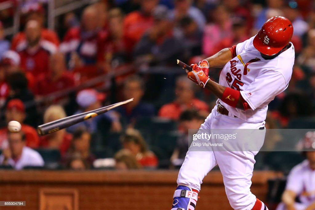 Dexter Fowler #25 of the St. Louis Cardinals breaks his bat while hitting an RBI ground out against the Chicago Cubs in the sixth inning at Busch Stadium on September 28, 2017 in St. Louis, Missouri.
