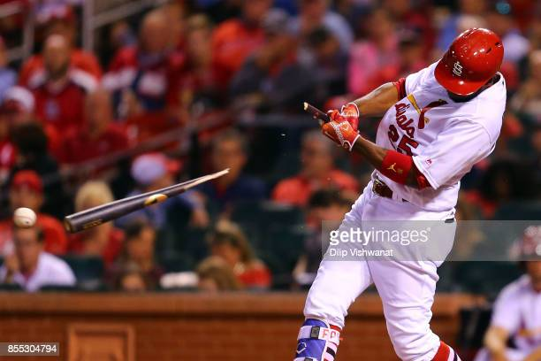 Dexter Fowler of the St Louis Cardinals breaks his bat while hitting an RBI ground out against the Chicago Cubs in the sixth inning at Busch Stadium...