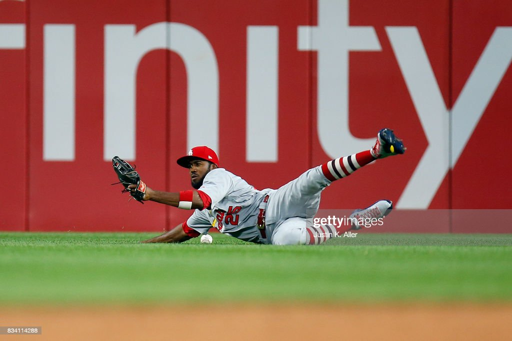 Dexter Fowler #25 of the St. Louis Cardinals can't make a catch in the third inning against the Pittsburgh Pirates at PNC Park on August 17, 2017 in Pittsburgh, Pennsylvania.