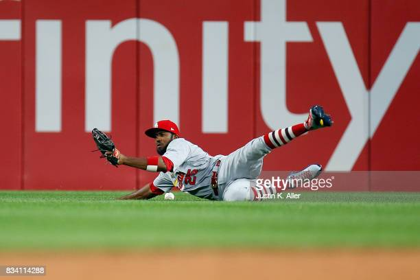 Dexter Fowler of the St Louis Cardinals can't make a catch in the third inning against the Pittsburgh Pirates at PNC Park on August 17 2017 in...
