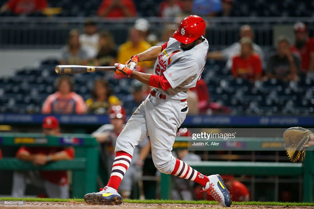 Dexter Fowler #25 of the St. Louis Cardinals hits a two RBI triple in the seventh inning against the Pittsburgh Pirates at PNC Park on August 17, 2017 in Pittsburgh, Pennsylvania.