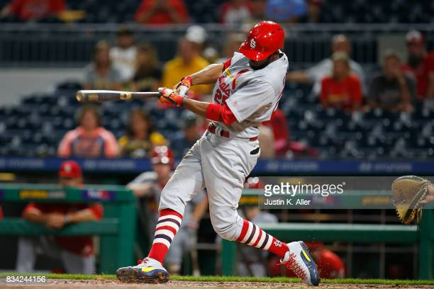 Dexter Fowler of the St Louis Cardinals hits a two RBI triple in the seventh inning against the Pittsburgh Pirates at PNC Park on August 17 2017 in...