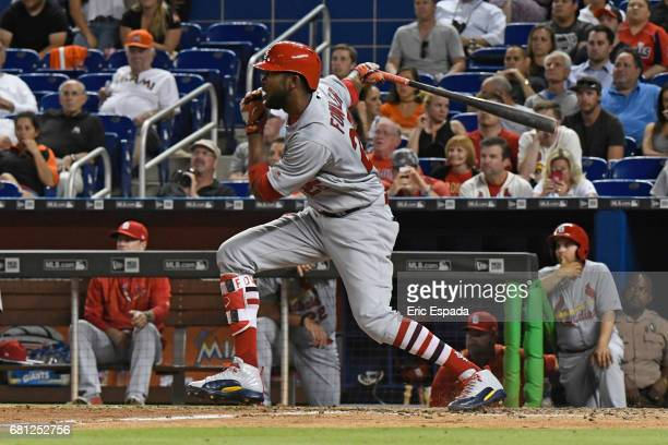 Dexter Fowler of the St Louis Cardinals hits an RBI single in the ninth inning against the Miami Marlins at Marlins Park on May 9 2017 in Miami...