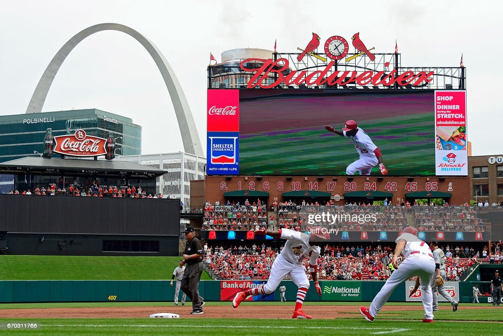 Dexter Fowler #25 of the St. Louis Cardinals is congratulated by third base coach Chris Maloney #77 after hitting a solo home run against the Pittsburgh Pirates during the third inning at Busch Stadium on April 19, 2017 in St Louis, Missouri.