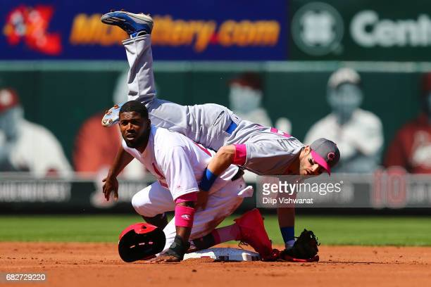 Dexter Fowler of the St Louis Cardinals is out in a double play against Tommy La Stella of the Chicago Cubs in the first inning at Busch Stadium on...