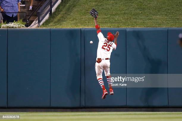 Dexter Fowler of the St Louis Cardinals is unable to catch an insidethepark home run by Adam Frazier of the Pittsburgh Pirates during the seventh...