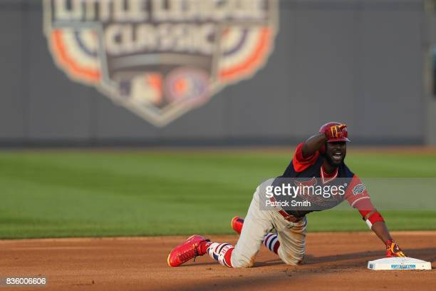 Dexter Fowler of the St Louis Cardinals reacts after sliding into Josh Harrison of the Pittsburgh Pirates during the first inning in the inaugural...