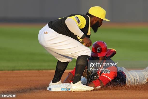 Dexter Fowler of the St Louis Cardinals slides into Josh Harrison of the Pittsburgh Pirates during the first inning in the inaugural MLB Little...
