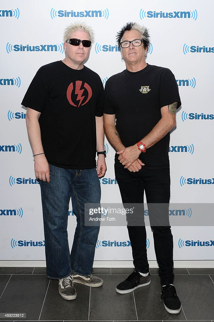 Dexter Holland (L) and Kevin Wasserman aka Noodles of band The Offspring visit SiriusXM Studios on August 5, 2014 in New York City.