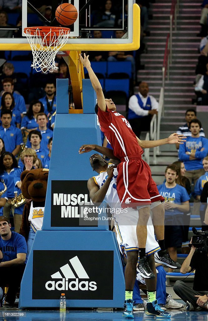 Dexter Kernich-Drew #34 of the Washington State Cougars shoots a reverse shot over <a gi-track='captionPersonalityLinkClicked' href=/galleries/search?phrase=Shabazz+Muhammad&family=editorial&specificpeople=7447677 ng-click='$event.stopPropagation()'>Shabazz Muhammad</a> #15 of the UCLA Bruins at Pauley Pavilion on February 9, 2013 in Los Angeles, California. UCLA won 76-62.