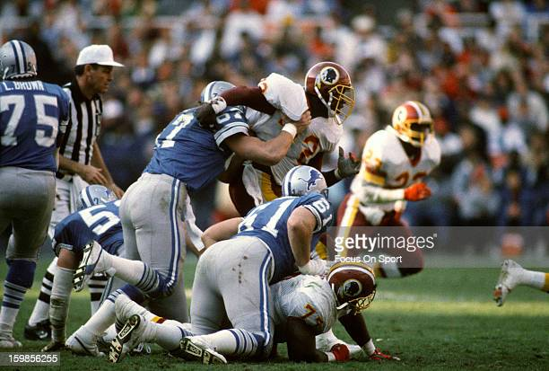 Dexter Manley of the Washington Redskins gets blocked by Greg Orton of the Detroit Lions during an NFL football game November 15 1987 at RFK Memorial...