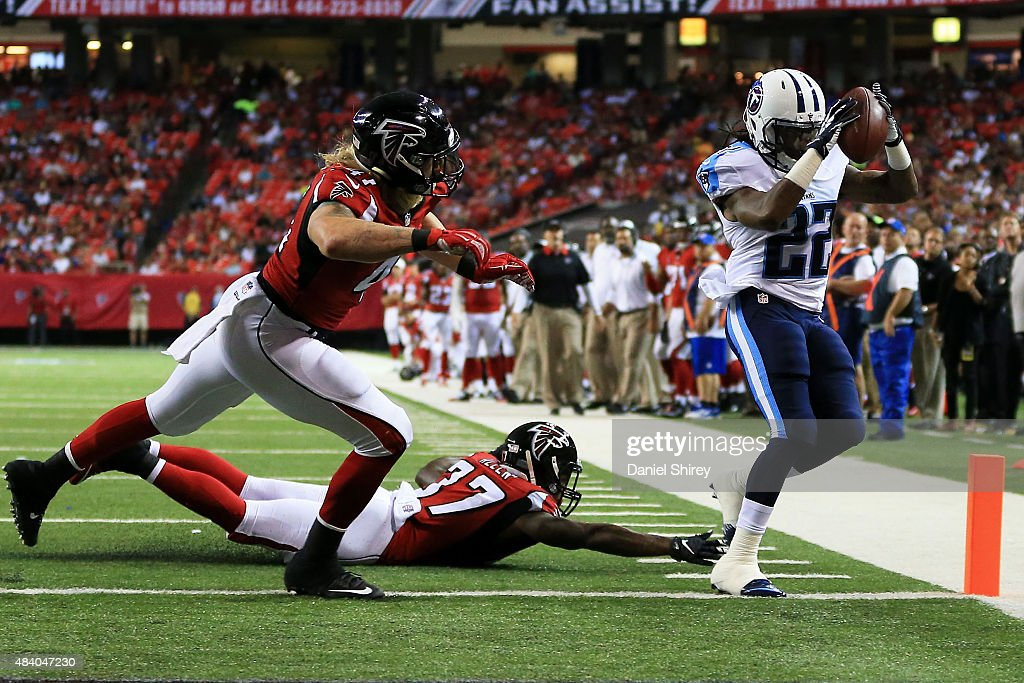 <a gi-track='captionPersonalityLinkClicked' href=/galleries/search?phrase=Dexter+McCluster&family=editorial&specificpeople=5509713 ng-click='$event.stopPropagation()'>Dexter McCluster</a> #22 of the Tennessee Titans runs past <a gi-track='captionPersonalityLinkClicked' href=/galleries/search?phrase=Tyler+Starr&family=editorial&specificpeople=12525577 ng-click='$event.stopPropagation()'>Tyler Starr</a> #41 and <a gi-track='captionPersonalityLinkClicked' href=/galleries/search?phrase=Ricardo+Allen&family=editorial&specificpeople=7172781 ng-click='$event.stopPropagation()'>Ricardo Allen</a> #37 of the Atlanta Falcons to score a touchdown in the first half of a preseason game at the Georgia Dome on August 14, 2015 in Atlanta, Georgia.