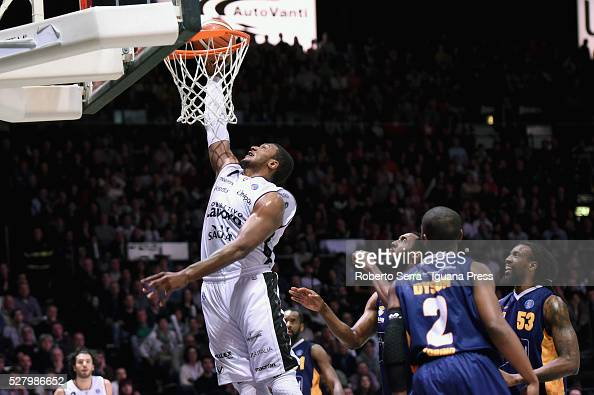 Dexter Pittman of Obiettivo Lavoro competes with DJ White and Jerome Dyson and Ndudi Ebi of Manital during the LegaBasket match between Virtus...
