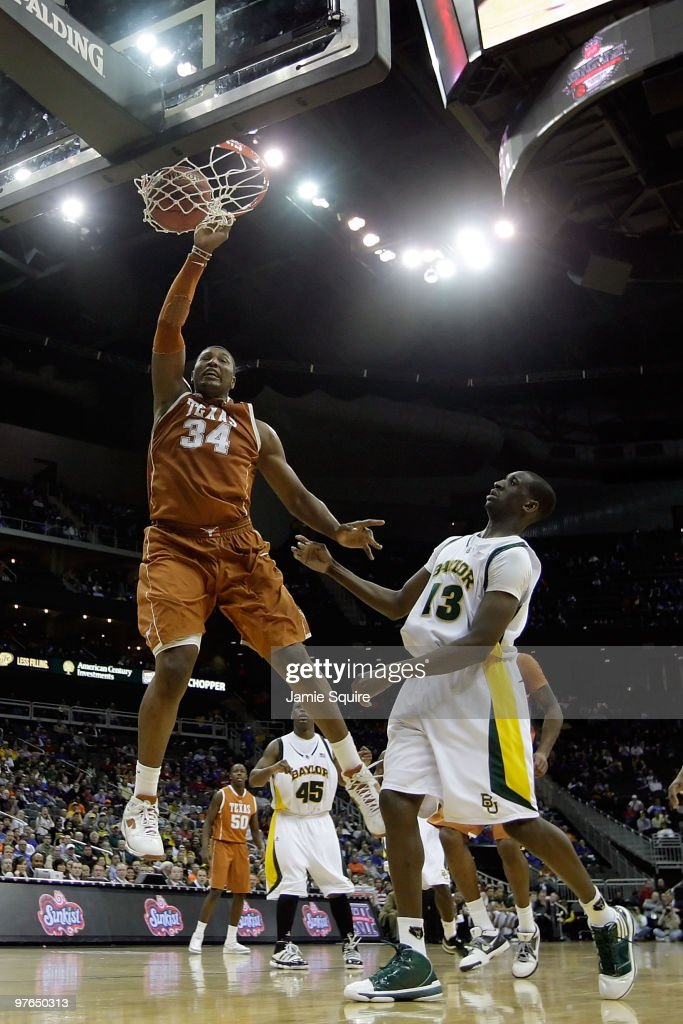 Dexter Pittman #34 of the Texas Longhorns dunks the ball in front of Ekpe Udoh #13 of the Baylor Bears in the second half during the quarterfinals of the 2010 Phillips 66 Big 12 Men's Basketball Tournament at the Sprint Center on March 11, 2010 in Kansas City, Missouri.