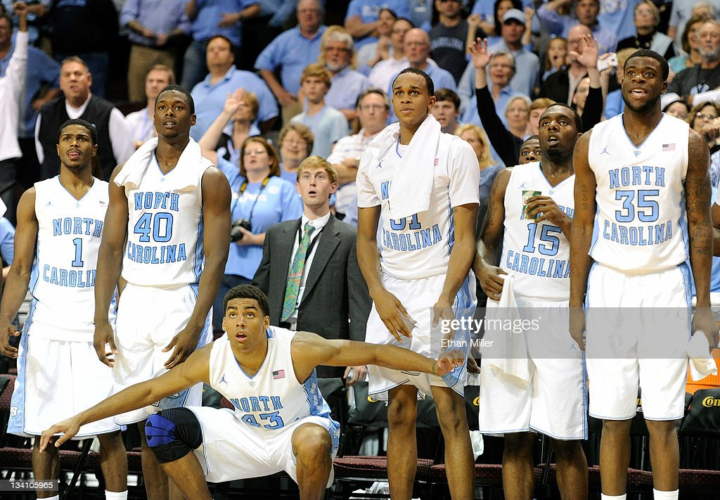Dexter Strickland #1, Harrison Barnes #40, James Michael McAdoo #43, John Henson #31, P.J. Hairston #15 and Reggie Bullock #35 of the North Carolina Tar Heels react on the bench as they watch teammates play late in their game against the South Carolina Gamecocks during the third round of the Continental Tire Las Vegas Invitational at the Orleans Arena November 25, 2011 in Las Vegas, Nevada. North Carolina won 87-62.