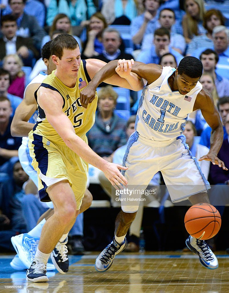 Dexter Strickland #1 of the North Carolina Tar Heels battles for a loose ball with Daniel Miller #5 of the Georgia Tech Yellow Jackets during play at the Dean Smith Center on January 23, 2013 in Chapel Hill, North Carolina. North Carolina won 79-63.