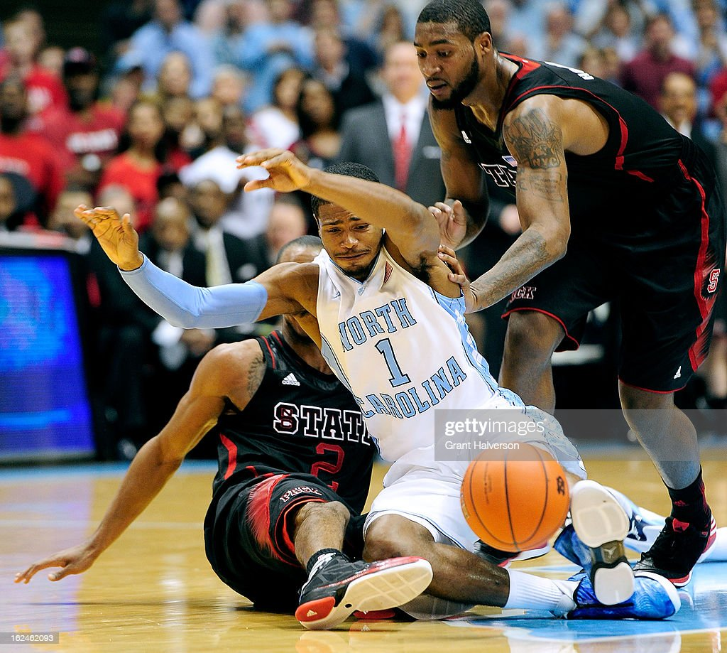 <a gi-track='captionPersonalityLinkClicked' href=/galleries/search?phrase=Dexter+Strickland&family=editorial&specificpeople=5792010 ng-click='$event.stopPropagation()'>Dexter Strickland</a> #1 of the North Carolina Tar Heels battles for a loose ball with Lorenzo Brown #2 and <a gi-track='captionPersonalityLinkClicked' href=/galleries/search?phrase=Richard+Howell&family=editorial&specificpeople=2313901 ng-click='$event.stopPropagation()'>Richard Howell</a> #1 of the North Carolina State Wolfpack during play at the Dean Smith Center on February 23, 2013 in Chapel Hill, North Carolina. North Carolina won 76-65.