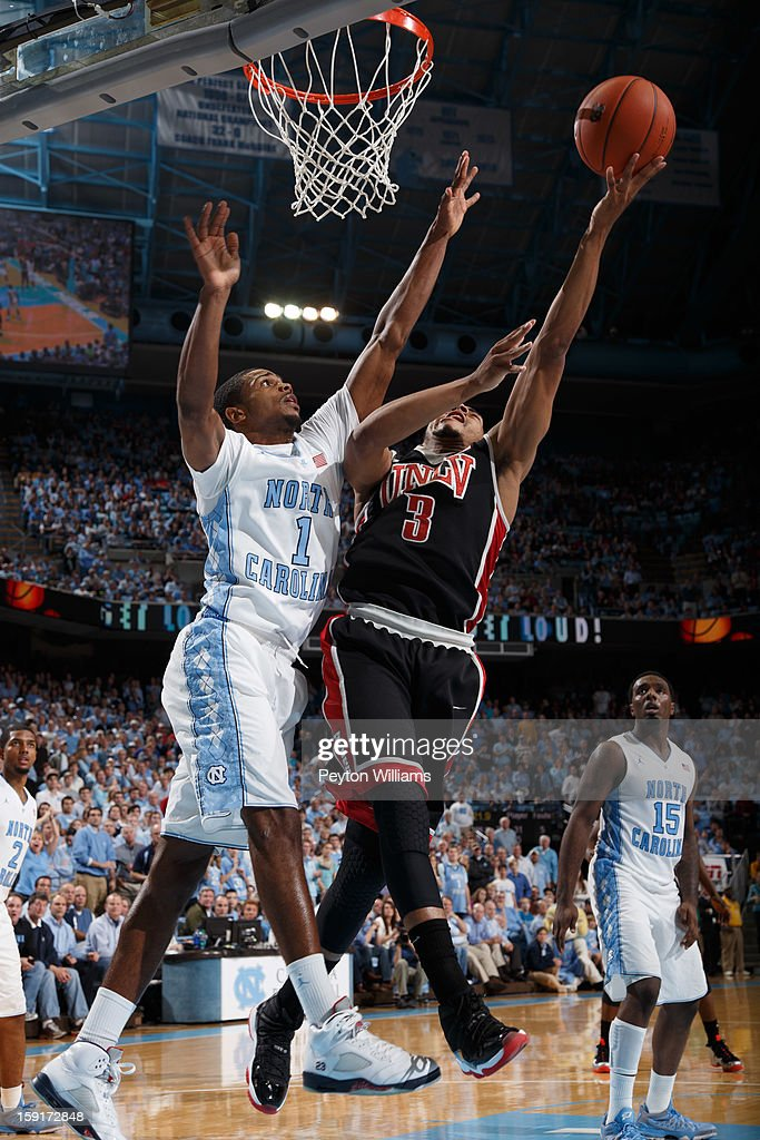 Dexter Strickland #1 of the North Carolina Tar Heels defends Anthony Marshall #3 of the UNLV Rebels on December 29, 2012 at the Dean E. Smith Center in Chapel Hill, North Carolina. North Carolina won 73-79.