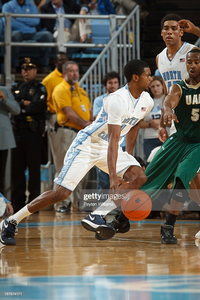 <a gi-track='captionPersonalityLinkClicked' href=/galleries/search?phrase=Dexter+Strickland&family=editorial&specificpeople=5792010 ng-click='$event.stopPropagation()'>Dexter Strickland</a> #1 of the North Carolina Tar Heels dribbles the ball while playing the Alabama Birmingham Blazers on December 01, 2012 at the Dean E. Smith Center in Chapel Hill, North Carolina. North Carolina won 102-84.