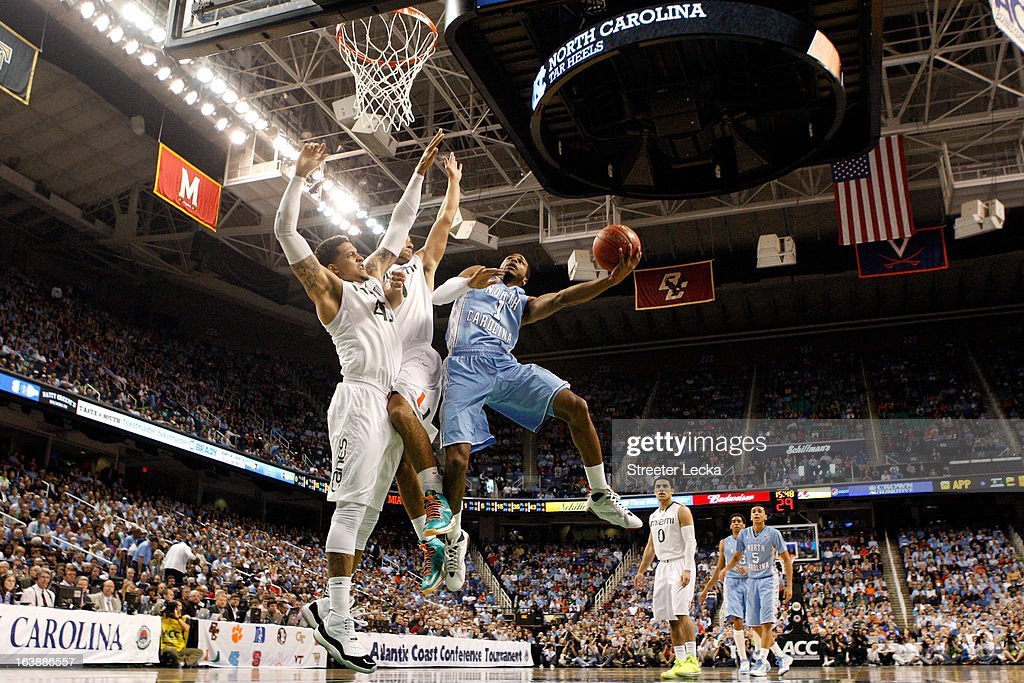 Dexter Strickland #1 of the North Carolina Tar Heels drives for a shot attempt in the first half against Julian Gamble #45 (L) and Trey McKinney Jones #4 of the Miami (Fl) Hurricanes during the final of the Men's ACC Basketball Tournament at Greensboro Coliseum on March 17, 2013 in Greensboro, North Carolina.