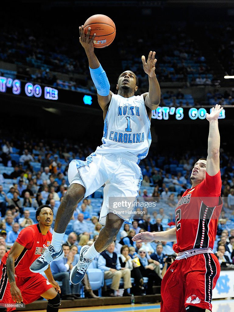 <a gi-track='captionPersonalityLinkClicked' href=/galleries/search?phrase=Dexter+Strickland&family=editorial&specificpeople=5792010 ng-click='$event.stopPropagation()'>Dexter Strickland</a> #1 of the North Carolina Tar Heels drives for layup against Tyler Strange #2 of the Gardner-Webb Bulldogs during play at the Dean Smith Center on November 9, 2012 in Chapel Hill, North Carolina.