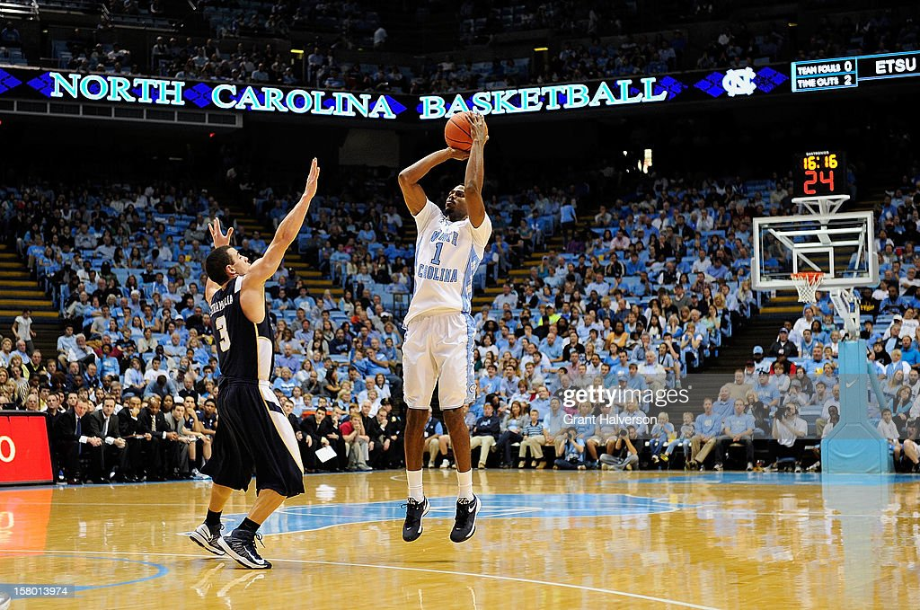 Dexter Strickland #1 of the North Carolina Tar Heels launches a three-point shot over Mario Stramaglia #3 of the East Tennessee State Buccaneers during play at Dean Smith Center on December 8, 2012 in Chapel Hill, North Carolina. North Carolina won 78-55.