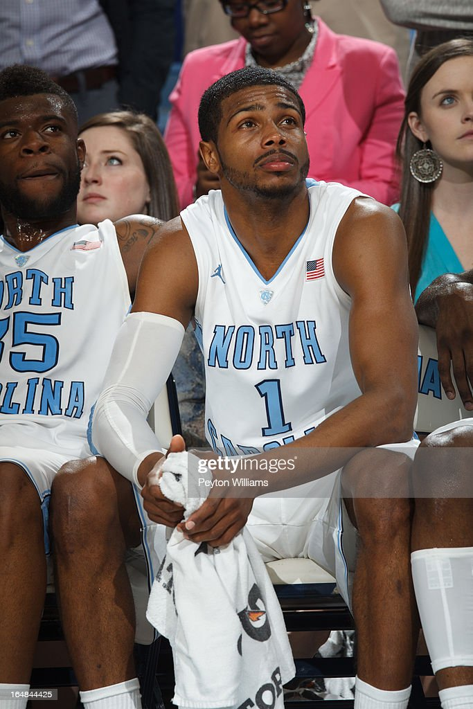 <a gi-track='captionPersonalityLinkClicked' href=/galleries/search?phrase=Dexter+Strickland&family=editorial&specificpeople=5792010 ng-click='$event.stopPropagation()'>Dexter Strickland</a> #1 of the North Carolina Tar Heels looks at a senior video and holds back emotion after a game against the Duke Blue Devils on March 09, 2013 at the Dean E. Smith Center in Chapel Hill, North Carolina. Duke won 69-53.