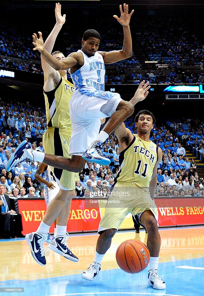 <a gi-track='captionPersonalityLinkClicked' href=/galleries/search?phrase=Dexter+Strickland&family=editorial&specificpeople=5792010 ng-click='$event.stopPropagation()'>Dexter Strickland</a> #1 of the North Carolina Tar Heels loses the ball as he drives hetween Daniel Miller #5 and Chris Bolden #11 of the Georgia Tech Yellow Jackets during play at the Dean Smith Center on January 23, 2013 in Chapel Hill, North Carolina. North Carolina won 79-63.